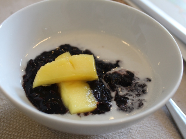 black rice pudding with coconut cream and toasted coconut