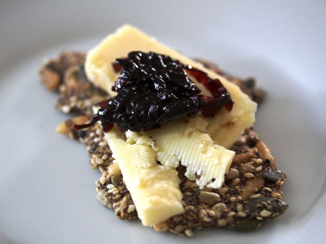 seed cracker with cheddar and prune and red onion chutney